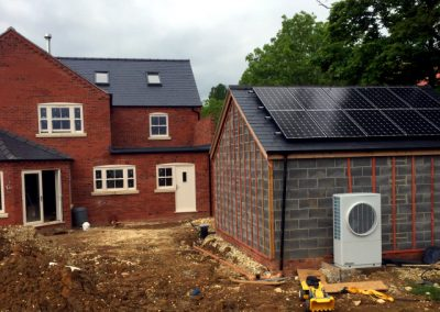 Dimplex A16M Air Source Heat Pump, with solar PV panels