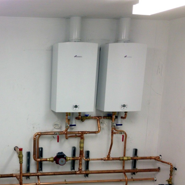 Installing Worcester Bosch CWi47 Greenspring natural gas water heaters for a factory renovation